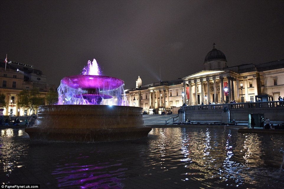 Trafalgar Square lit up pink to celebrate the birth of the royal baby girl - the as yet unnamed child is now fourth in line for the throne
