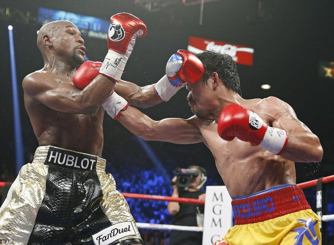 This one from Pacquiao gets through the Mayweather defence but the American is quick and manages to avoid taking the lot