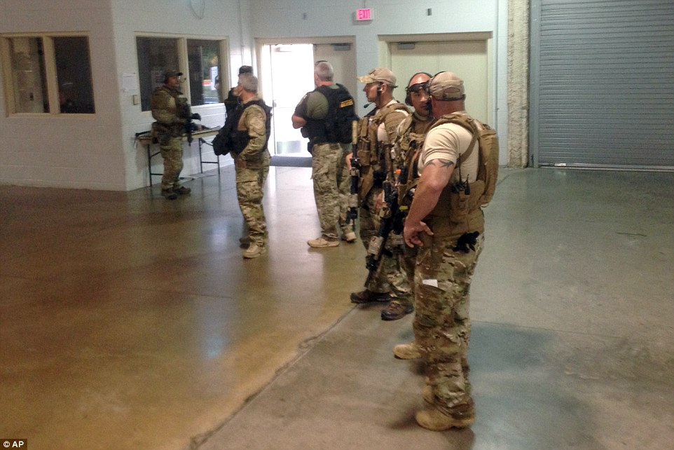 Members of the Garland Police Department  stand guard inside the Curtis Culwell Center in the aftermath of the shooting