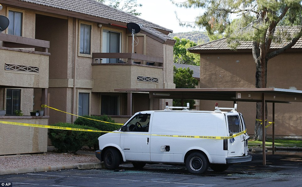Raid:Police tape surrounds a vehicle, believed to belong to one of the two gunmen, in Phoenix, Arizona on Monday