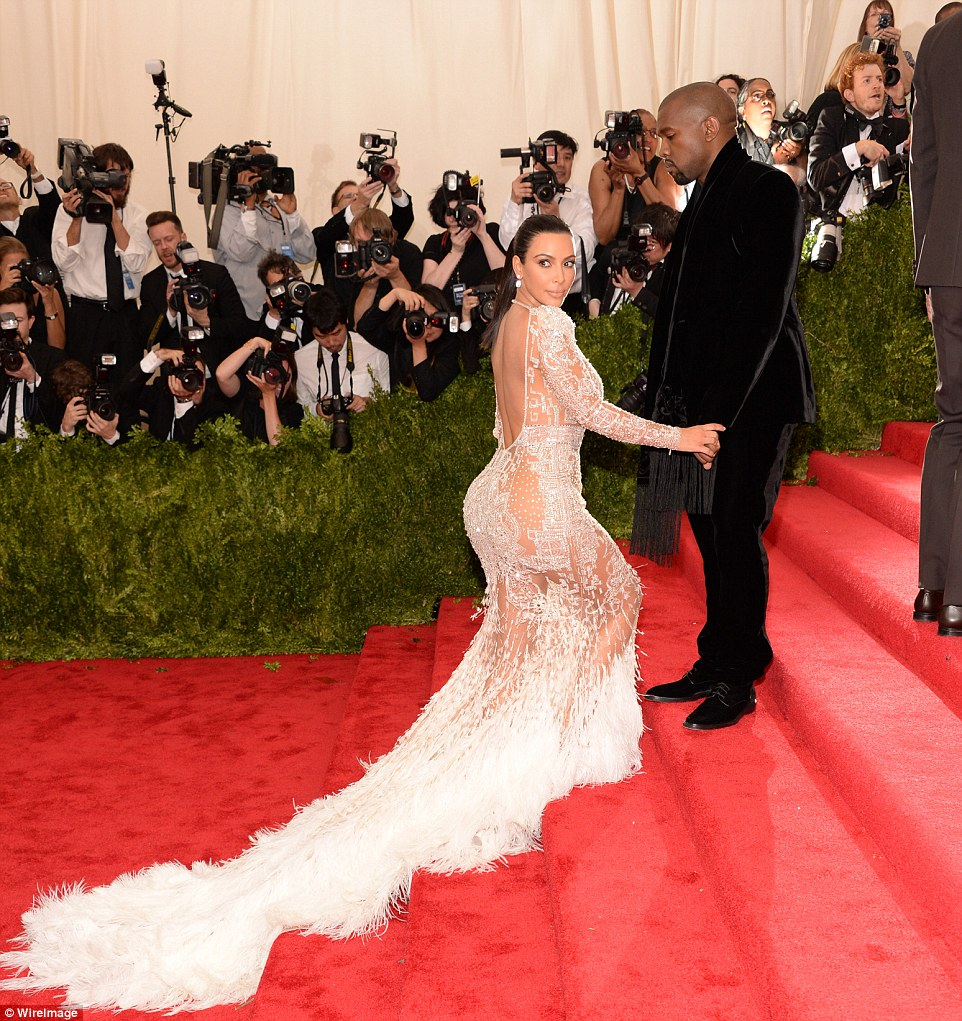 Daring to bare! Kim Kardashian made sure to put her best assets forward in a Roberto Cavalli gown on Monday night at the Met Gala in New York with her husband Kanye West