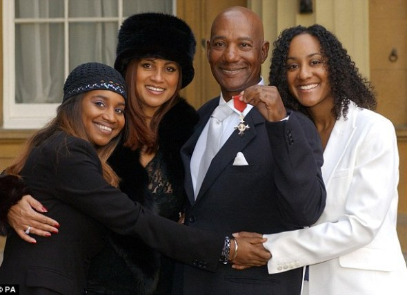 Honoured: The singer (pictured with wife Ginette and their daughters Leonie and Colette) died at home in the Bahamas