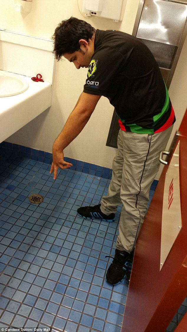 Mr Faisal pointed ot the floor, saying 'I have done it when you bring water from the sink down to the ground to wash your feet, but it makes too much of a mess, it is not clean and it makes the floor slippery and dangerous'