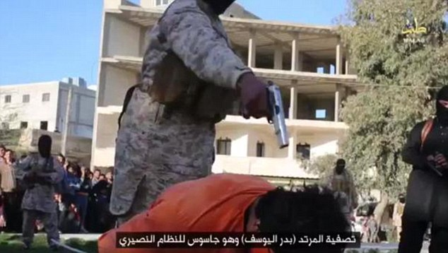 Executed before a baying crowd: An ISIS prisoner is forced to kneel before being shot in the back of the head by a militant after being accused of spying for Syrian President Bashar al Assad
