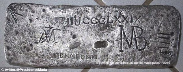 Valuable find: Soldiers have been guarding the 50kg silver bar on Sainte Marie Island, Madagascar, after it was brought ashore by divers led by US underwater archaeological explorer, Barry Clifford