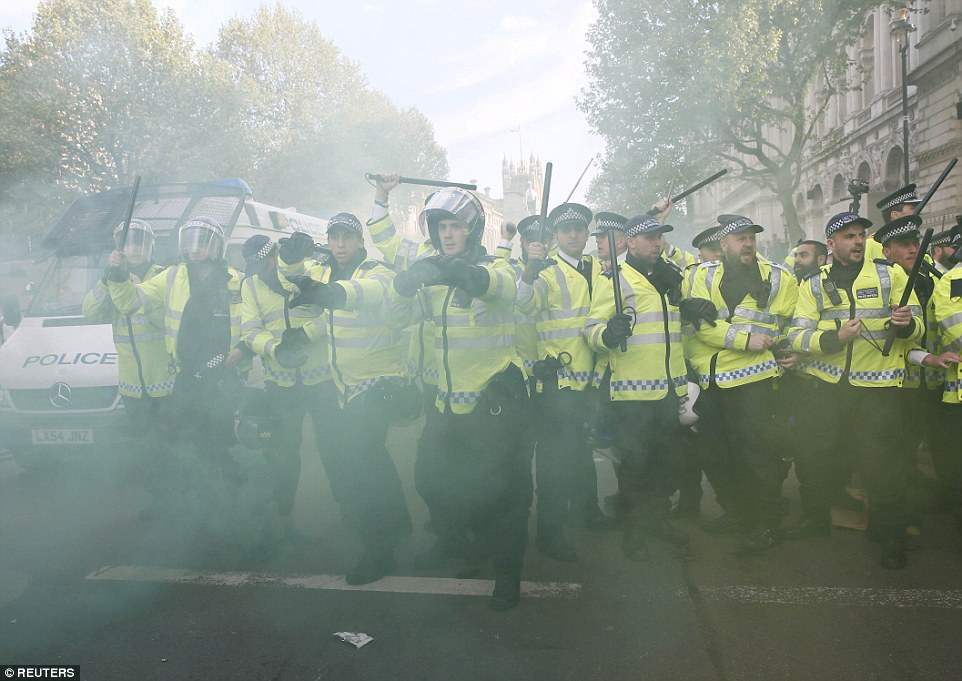 Protesters threw smoke bombs at police who were forced to respond with officers equipped with riot equipment to counter the threats