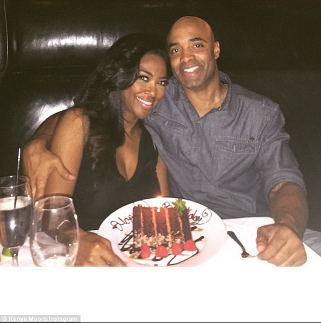 Together: Kenya Moore shared this photo of her and James Freeman after Millionaire Matchmaker aired on March 22 writing: 'Sometimes you can spend your whole life looking for Prince Charming when a King arrives'