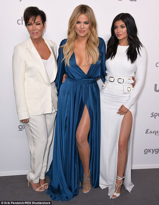 Center of attention: Khloe Kardashian stood out from her famous family as she sported a bright blue gown with a deeply plunging front while attending the NBC Universal Upfronts on Thursday