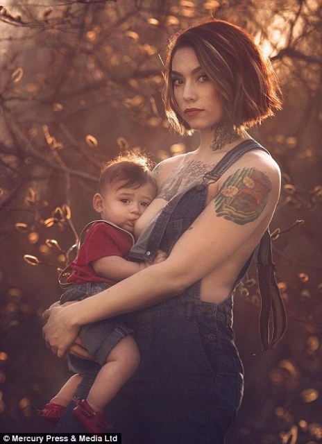 Powerful: A tattooed mother feeds her son