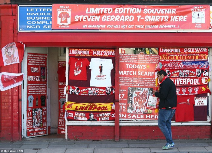 Sea of red: A shop front is covered by Gerrard memorabilia for sale ahead of the kick-off with Crystal Palace at Anfield