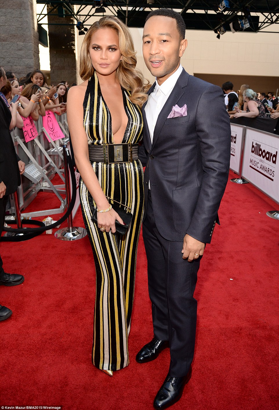Cute couple: 29-year-old Chrissy was all lashes and cleavage in her striped jumpsuit while posing on the arm of her husband John Legend, who's up for seven awards and will perform Like I'm Gonna Lose You with Meghan Trainor