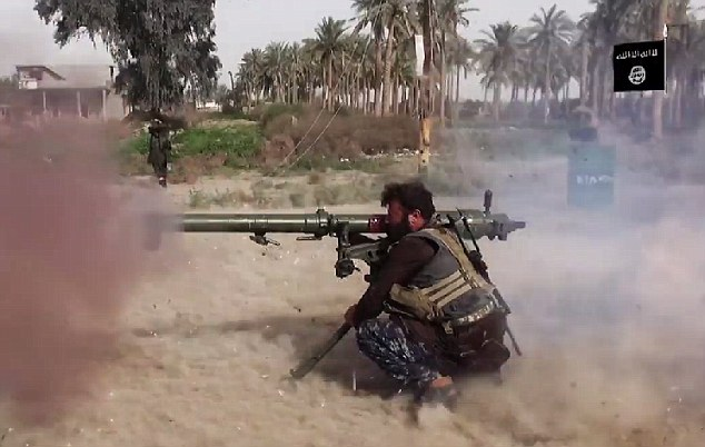 Pincer attack: As reports flood in that ISIS has taken over Ramadi, its militants have also been battling security forces in Samarra (pictured), around 70 miles north of Baghdad