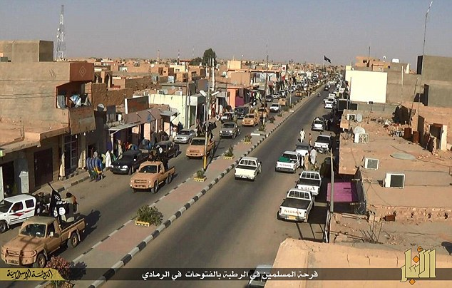Thousands of ISIS extremists paraded through the streets of Ramadi after capturing the city