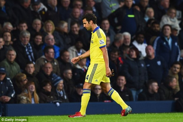 A dejected Fabregas trudges off the pitch after being given his marching orders following the controversial red