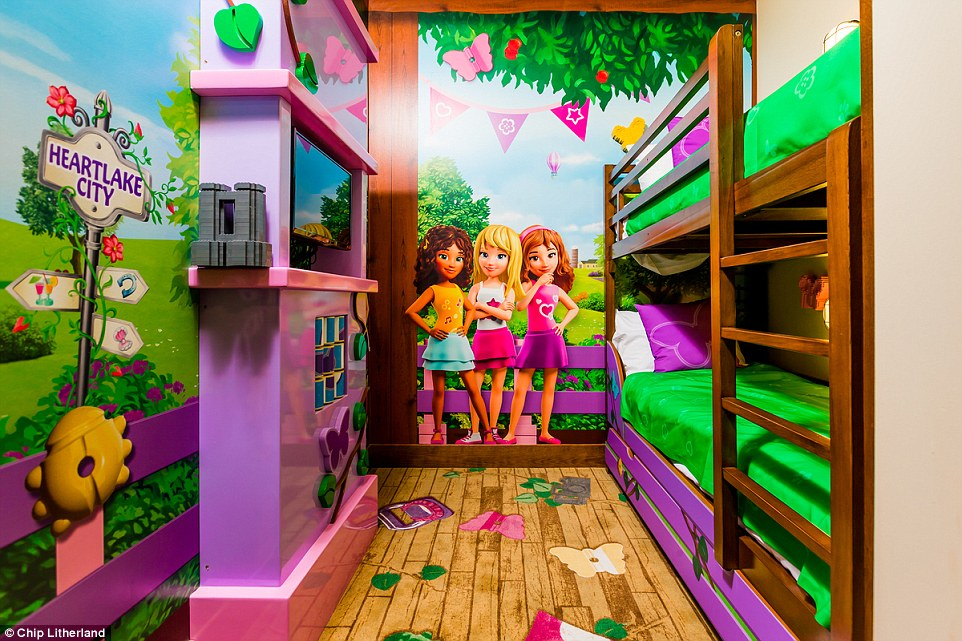 Each of the kids' rooms also features its own TV - but they'll need their sleep to take advantage of their early morning theme park access