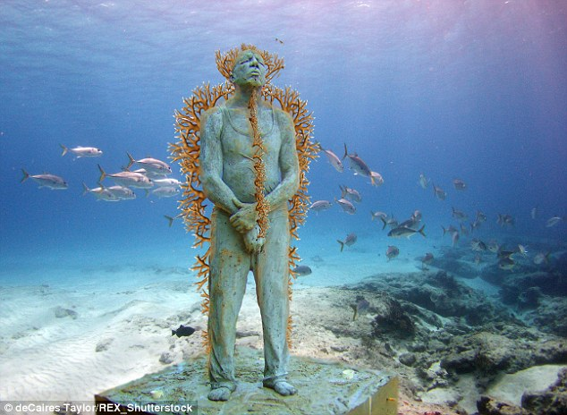 Cancun's Undwater Art Museum, consisting of more than 500 life-sized sculptures stood fixed to the seabed, all crafted from specialized clay to promote coral life