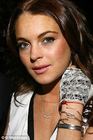 Stars: Celebrities including Lindsay Lohan, pictured, and Charlize Theron were also seen with the bracelets
