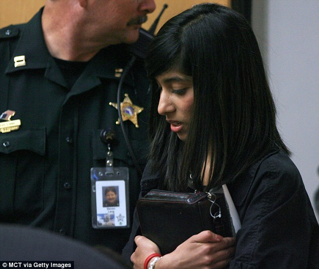 Thrust into the limelight: Bary made headlines when at age 16 she boarded a Greyhound bus in Ohio and traveled 1,000 miles to seek refuge from her parents in Central Florida. Here she is pictured August 21, 2009, entering a Florida courtroom clutching her Bible