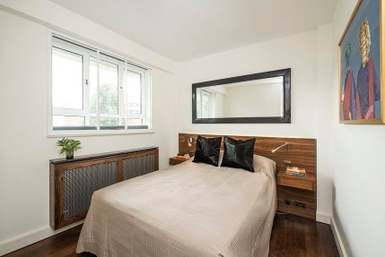 Fancy: The third-floor flats (pictured is the £1million flat) have two bedrooms with a wood theme and hand-crafted chevron flooring throughout