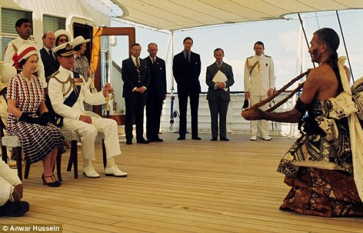 Queen Elizabeth ll and Prince Philip, Duke of Edinburgh are entertained by Fijian folk and traditional dancers on board the Royal Yacht Britannia in 1977