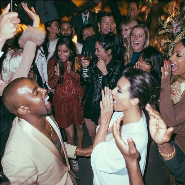Throwing shapes: Kanye and Kim let loose on the dancefloor and boogied 'all night in the rain'
