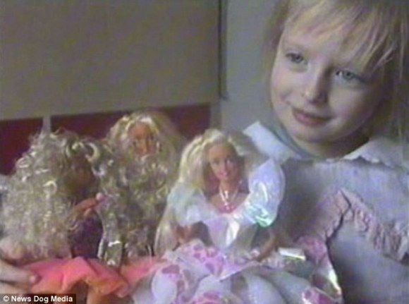 Angelica, pictured with her Barbie collection aged six, says that if she ever tried to leave home and live without her parents, it would be 'a scandal'