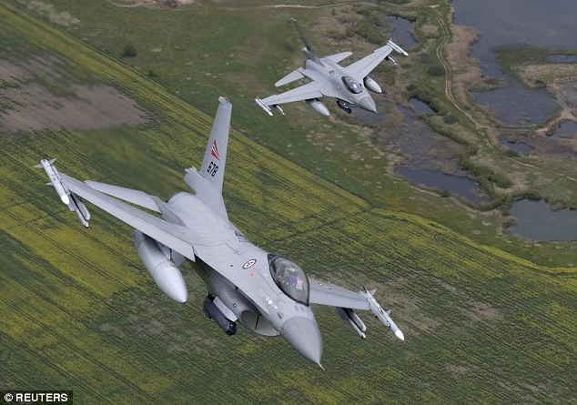 Patrol: Norwegian Air Force F-16 fighter jets flies over Lithuania during exercises last week. Moscow responded to Nato's actions with a a massive 'surprise' military drill featuring 12,000 soldiers and 250 aircraft
