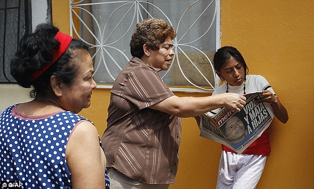 Stunned: Other residents of the Iztapalapa neighborhood in Mexico City read about the arrests