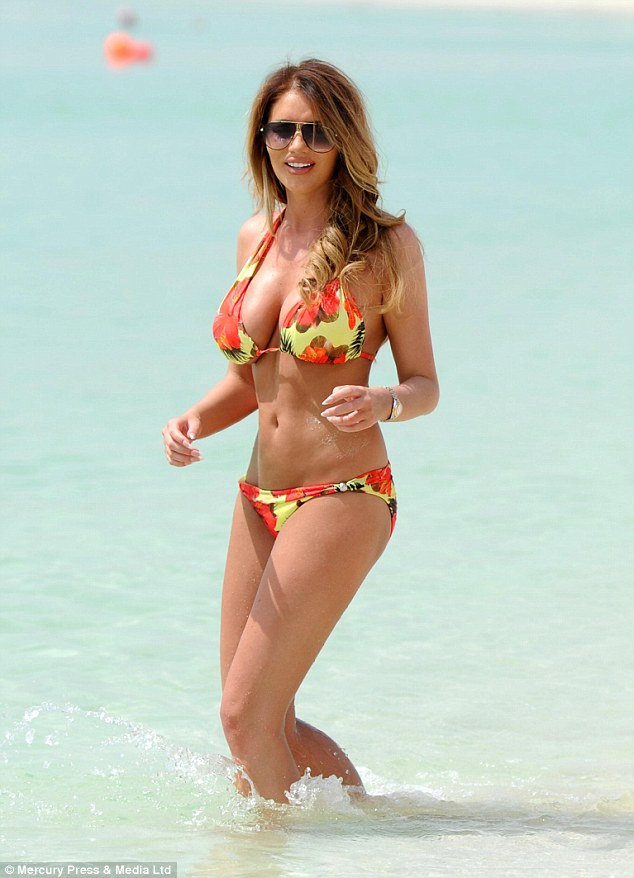 Sizzling: The former TOWIE starlet looked incredible in a tropical bikini as she played in the water