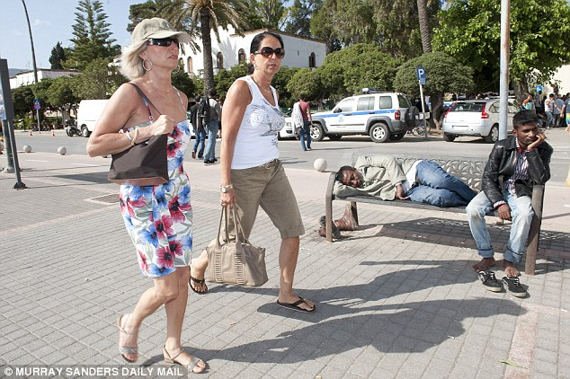 Despite an ever increasing number of homeless migrants swarming on the island, life goes on for tourists and permanent residents