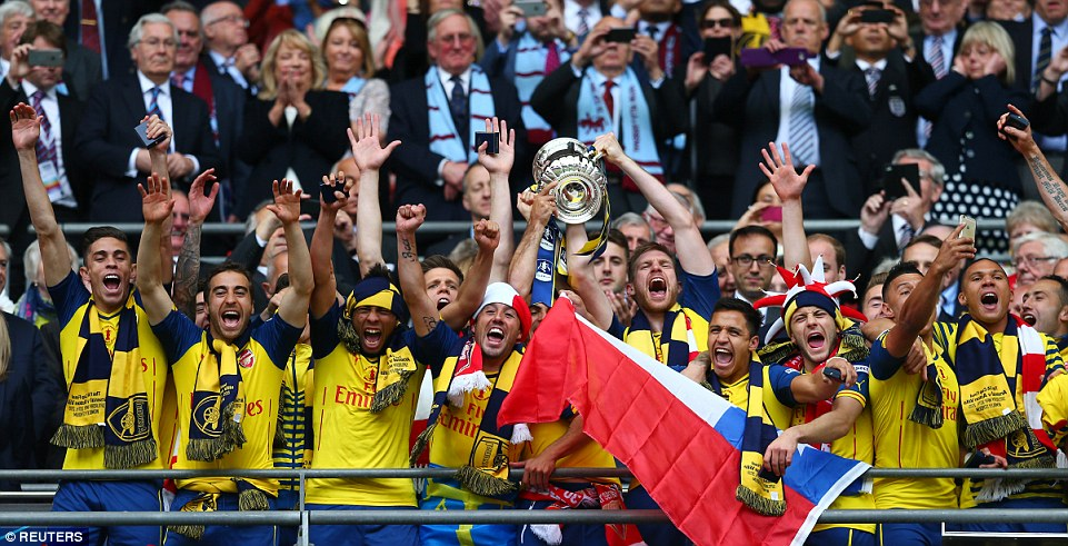Arsenal lift the FA Cup trophy after the Gunners beat Villa with goals from Theo Walcott, Alexis Sanchez, Per Mertesacker and Olivier Giroud