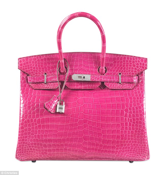 The luxury crocodile skin Hermes Birkin bag, in fuchsia, features 18 karat gold detailing encrusted in real diamonds