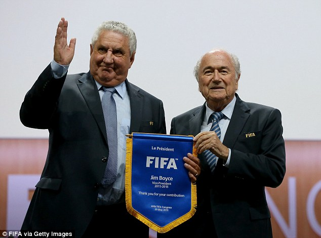 Jim Boyce, receiving a pennant for his contribution, stepped down as vice president of FIFA on Friday