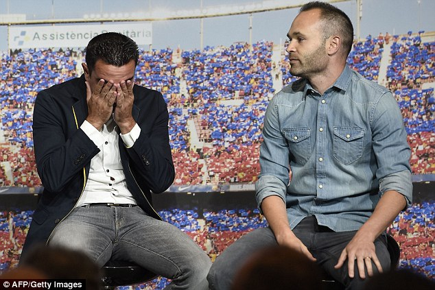 Barcelona star Xavi (left) was joined by team-mate Andres Iniesta at his farewell event at the Nou Camp
