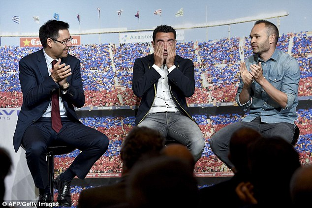 The two Barcelona stars were joined on the stage by club president Josep Maria Bartomeu (left)