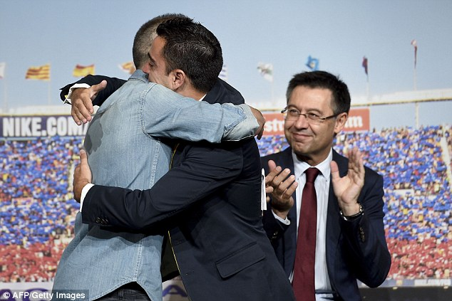 The former Spain international hugged Iniesta as he entered the stage and struggled to hold in his emotions