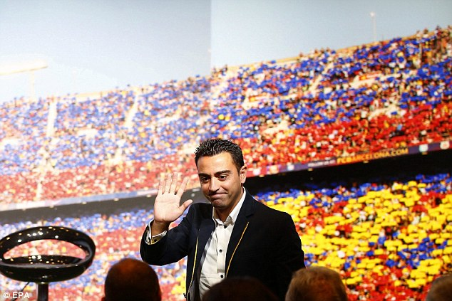 Xavi waves to the crowd, which included his family and team-mates, as he prepares to play in his final match