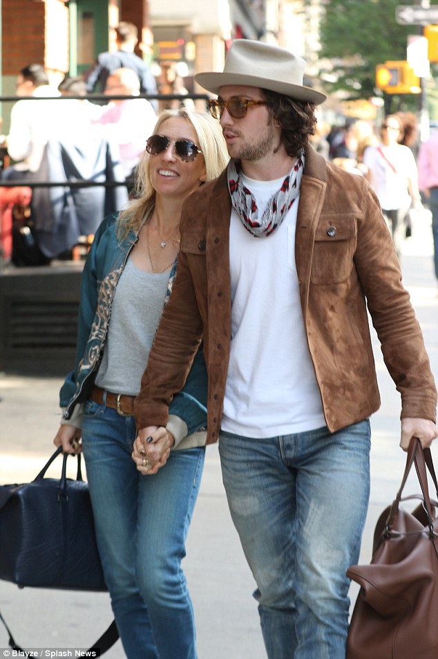 Sam Taylor-Johnson and husband Aaron ditch the kids for ...
