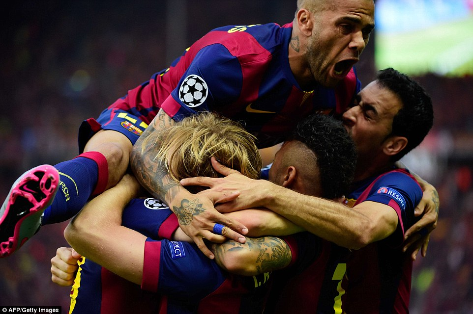 Rakitic is mobbed by a flying Dani Alves, grabbed by an exuberant Neymar and a roaring Sergio Busquets after giving Barca an early lead