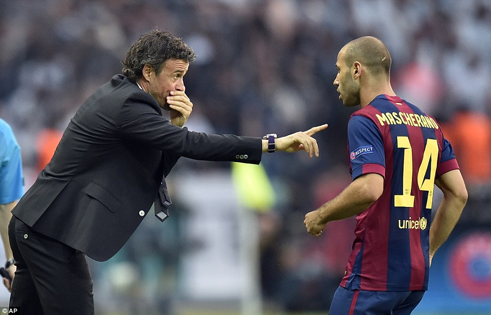 Luis Enrique gives Javier Mascherano instructions during a frantic opening to the game