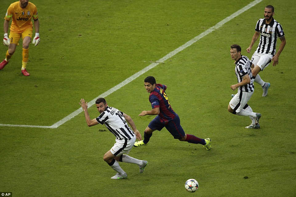 Time stands still as the slippery Suarez attempts to wrongfoot 34-year-old Andrea Barzagli in the Juventus penalty area