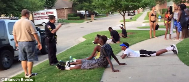 Everyone in the video that the officer is abusive or physical toward is black, while the child filming the incident - who is white - is never asked to sit down and stop what he is doing