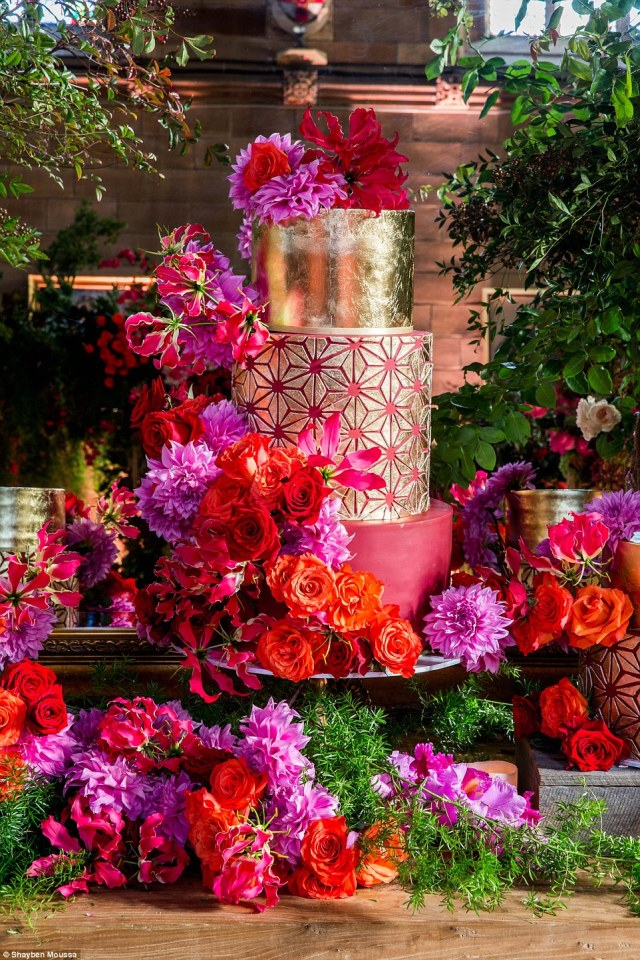 The wedding cake consisted of three bespoke hand-painted cakes, each embellished with individual gold leaf geometric shapes