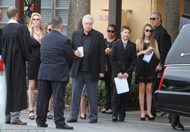 Victoria's heartbroken father also watched his daughter's casket as he stood by his wife outside the church