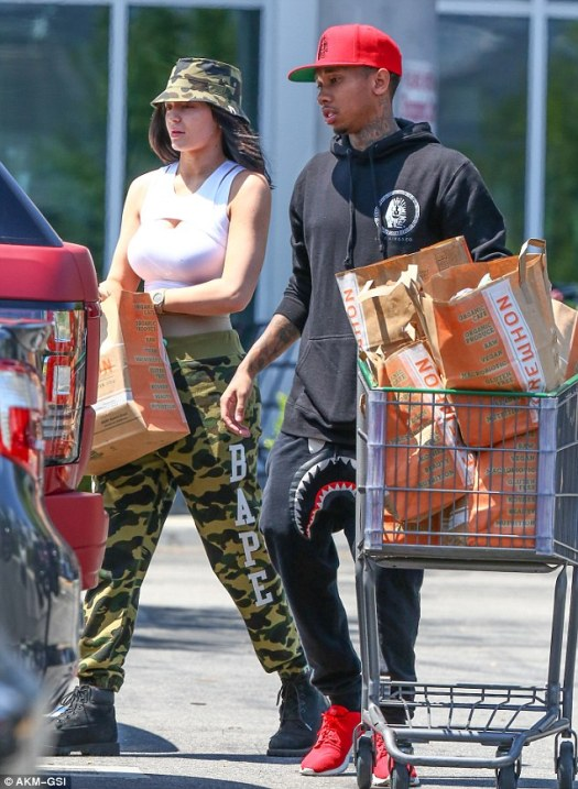 Kylie Jenner tries to keep a low profile with doting ...
