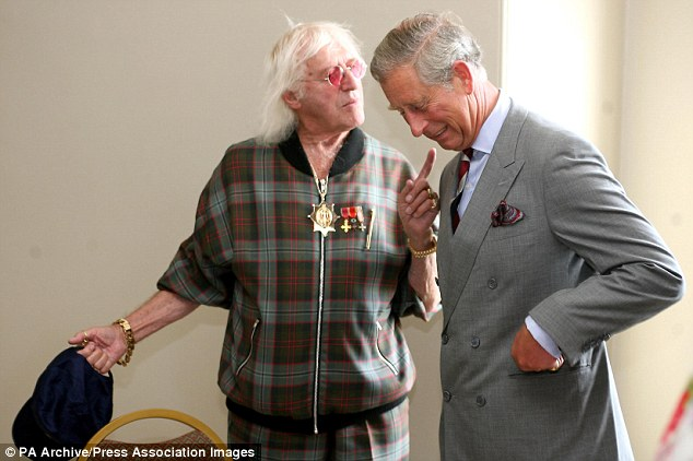 Unrivalled access: Jimmy Savile meets Prince Charles in 2007 - before his atrocious crimes came to light