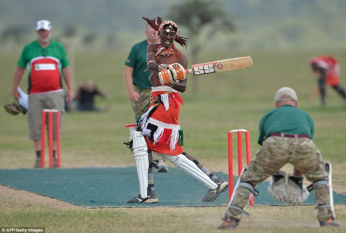 It's a hit: A member of the Maasai Cricket Warriors bats against the British Army Training Unit  team during a charity tournament in Kenya