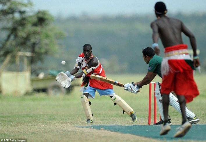 Catch attempt: The group of Maasai warriors came together to play cricket - but also to raise awareness of rhino poaching in the country