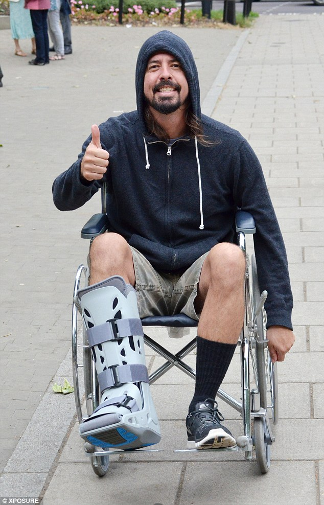 Foo Fighters Dave Grohl Pushed In Wheelchair By Wife