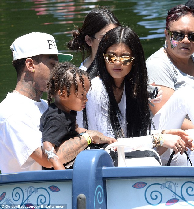 Stunna shades: Kylie concealed her eyes behind glamorous mirrored cat-eye shades as the sun glared down